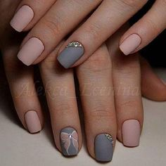 Simple yet gorgeous looking winter nail art design. The nail art design is made up of light pink and blue gray nail polish that perfectly complement each other. On top are simple details of a pink ribbon and small beads to enhance the design.