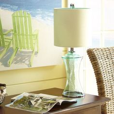 Pretty yet practical, our Sea Glass Lamp will brighten your life as well as your room. So place it where its translucent base and blue-lined shade will create the maximum visual impact. Sea what we mean?