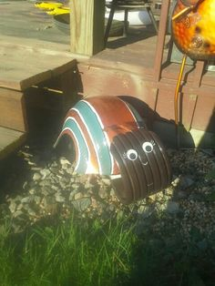 My attempt of a snail. Made from a recycled tire.