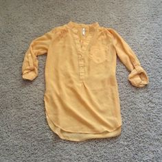 Gold Blouse Worn once! Looks great with leggings and tall boots. Light and flowy, semi sheer material. Longer, so it covers your butt! Says XS but fits more like a small. (**feel free to make an offer or ask me about bundles! Willing to make custom bundles with discounted prices if you ask and would post a listing just for you.) Tops Blouses