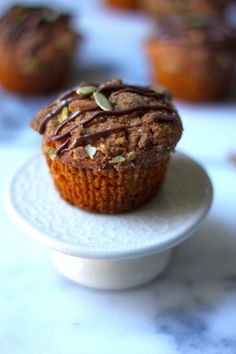 Pumpkin Banana Olive Oil Muffins with Crystalized Ginger Pepita Crumble and Nutella Drizzle by @Ashley Manila