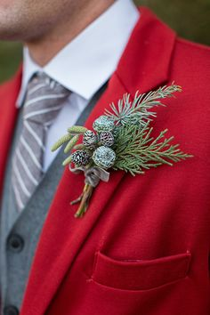 winter wedding boutonniere, photo by Tyler Rye Photography http://ruffledblog.com/a-desert-christmas-wedding #winterwedding #grooms