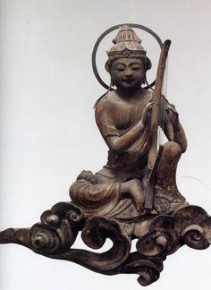 Bodhisattva playing. ca 1053. Byodoin Temple - Kyoto, Japan.