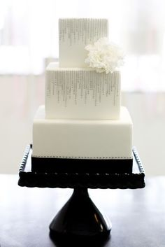 so in love with square wedding cakes lately. Love the diamonds on this, minus the flower.