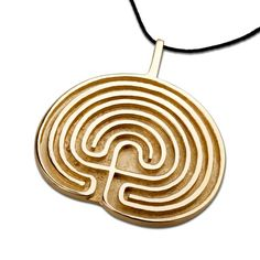 Labyrinth Pendant Gold - Unfold the path to higher dimensions and the secret of seven stages.  The seven fold Labyrinth - Secert path to higher dimensions   This labyrinth is an ancient symbol and can be found in many places in the world.   Spiritually, this labyrinth symbols the growth and development of men.   The seven stages of the labyrinth represent the stages in spiritual development as well as the 7 chakras and energetic centers of our bodies.