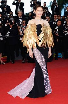 Laetitia Casta styled her appliqued Dior spring/summer 13 Couture gown with a gold feather bolero and Chamuet jewellery.