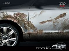 Advertisements can even use secondary images to draw in viewers. This Audi car add sets a scene in the side of a vehicle of asian style trees and a soaring bird to appeal to the asian market.