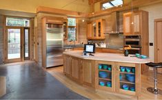 Clear glass splashback over rammed earth to protect it and to make it easy to clean - great idea!