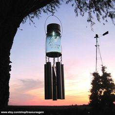 Mason Jar Windchime Light Solar Upcycled Garden Decor, Recycled Wind Chime Mason Jar Solar Light. $38.00, via Etsy.