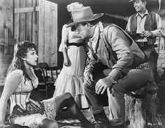 John Wayne and Maureen O'Hara in McLintock! (1963).- he can tell me what to do any day!