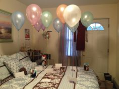 "Pictures and ""open when...."" Envelopes hanging from balloons! Perfect birthday gift for boyfriend/husband!"