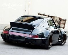 Duck... I said DUCK!  Classic 911 shape with RWB style elements......