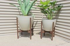 Learn how to build modern, wooden planter stands to freshen up your outdoor spaces with beautiful plants.