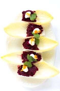 "Beet ""Tartare""  Earthy roasted beets are brightened by fresh orange zest and tangy balsamic in this clever appetizer, which looks beautiful presented in individual endive spears. To make this dish vegan, omit the Greek yogurt or use a non-dairy yogurt alternative."