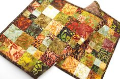 Quilted Table Runner in Colorful Batik Fabrics, Fall Color Patchwork Table Decor by MyBitOfWonder on Etsy https://www.etsy.com/listing/274020362/quilted-table-runner-in-colorful-batik