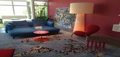Modern Home Decor with Red Embryo Chair and Blue Sofa
