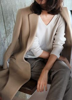 creamy cashmere sweater w/ taupe trousers and a tan peacoat for fall