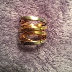 Michael Kors Tri-Tone Intertwined Ring The ring is in great condition! I only wore it a few times. There's hardly no scratches on the ring. Michael Kors Jewelry Rings
