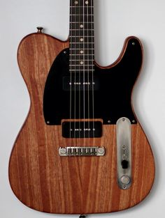 Fader Wire & Wood Custom Telecaster Feather weight fully hollow mahogony body Special blended oil/wax finish Matte black pickguard Custom Wound Fralin Alnico VIII hum cancelling P-90's Fralin Sunbucker pickup under the pickguard in middle position Custom electronics include a S-1 switch that engages tone cap for cocked wah on bridge pickup 5 way switching 1.bridge 2. bridge+middle (half out of phase ) 3.bridge+neck 4.Middle+neck 5.neck Mahogany Custom profile late 50's gibson neck