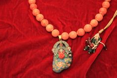 Pendant with enameling with peach color  beads