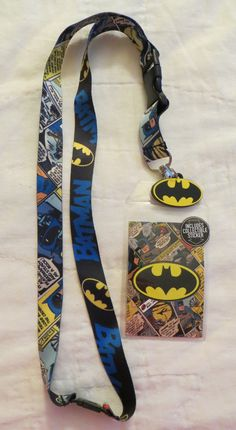This lanyard is an officially licensed product featuring different artwork on each side of the fabric. Features: - Two Different Prints on the Fabric - Batman's Logo Charm - Plastic Insert With Free S