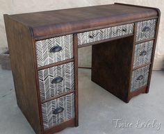 Twicelovely refinished the ugly wood finish this desk had, then painted the drawers black and created this herringbone pattern with a paint pen! Then simply added some hardware and she had a lovely piece! Only wish I knew how much she spent/how much she sold for.