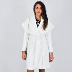 Keepsake || Ivory 'Cape' Tie Front Coat The 'Wide Awake' Coat is a slim fitting coat with a short shoulder cape, waist tie and fitted long sleeves in a mid-weight fabric with lining. Designed in Australia. Designer Carried by Nasty Gal & ASOS. Available in Size XS(0-2) and Small(4-6).  MAIN: 67% POLYESTER 31% RAYON 2% ELASTANE   LINING: 97% POLYESTER 3% ELASTANE Nasty Gal Jackets & Coats Capes