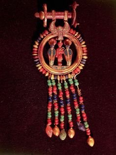 Earring from the Tomb of Tutankhamun  Gold, lapis lazuli and other semi-precious stones. Valley of the Kings KV62 , Thebes, Luxor. New Kingdom, 18th Dynasty, c. 1341-1323 BC. Egyptian Museum, Cairo.
