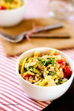 Summer Veggie Quinoa Bowl - Cooking Quinoa. This is a tasty, veggie packed salad! Very easy to make.
