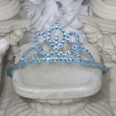 This adorable pale #blue princess #accessories tiara crown  makes a great gift for any occasion.  Blue tiara band with light blue rhinestones will bring out the  glam in any ... #etsy #hair #crowns #tiaras #brazen