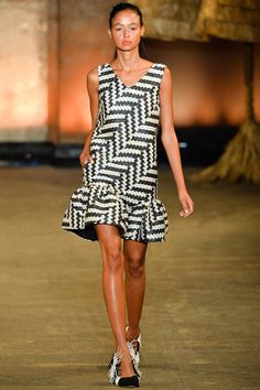 """Spring 2014 Ready-to-Wear Christian Siriano /  A long-planned vacation to Mexico's Isla Mujeres provided Christian Siriano with just the right inspiration to build his Spring collection. """"There was something so cool about the neon-painted houses and the women selling handwoven baskets in tiny markets,"""" the designer said backstage before his runway show."""