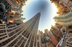 Empire State building in New York with a fisheye lens which get all 360 degrees of the city into view