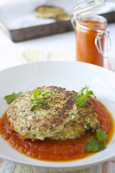 Cauliflower Quinoa Cakes. Easy and delicious and loaded with lean protein! http://www.beyondthepeel.net/2013/07/cauliflower-quinoa-cakes-with-roasted-pepper-and-tomato-sauce.html