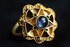 This medievel sapphire-set ring has stumped archaeologists as to its origin.
