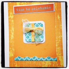 Birthday card with orange paper gift cutout and ribbon.