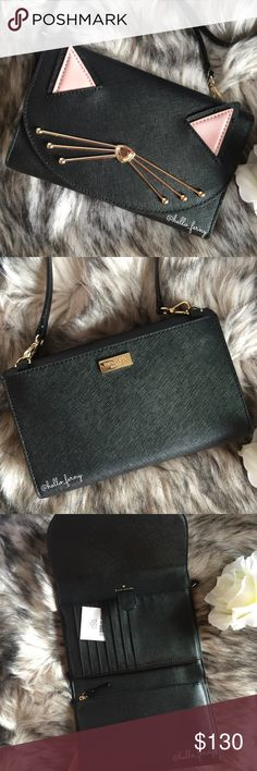 """Kate Spade Black Cat Jazz Winni CrossBody Clutch. NWT. Kate Spade Black Cat Jazz Winni CrossBody Clutch in black leather organizer handbag. Mini convertible crossbody to clutch fits your phone and essentials with domed compartment with card alots etc. All leather bag in black leather with bling cat details. Measures approximately 7 1/2"""" x 5"""", shoulder strap drop is approximately 22"""". Removeable strap, back slip pocket. kate spade Bags Crossbody Bags"""