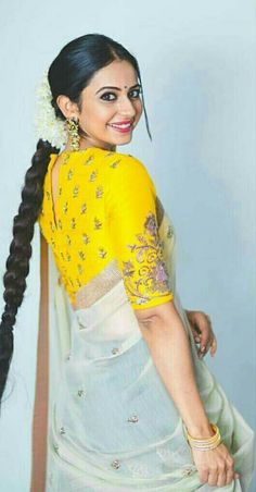 Gorgeous creak saree paired with bright yellow blouse.