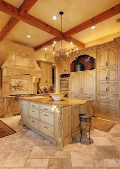 Heyl Homes Luxury Home Gallery. Beautiful antique white kitchen, stone stove top, lovely for French country home. Traditional classic french country kitchen antique white