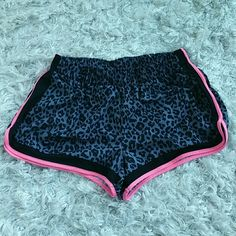Wish&Whim fun animal print shorts Fun and playful animal print shirts by Wish&Whim. Not new, gently used ,in good condition.  Colors are gray and black with pink trim. Size xlarge Wish&Whim Shorts