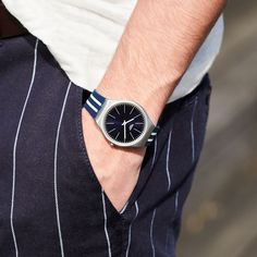 With SKINBLUEIRON, it's high tides all times. When a navy blue silicone bracelet contrasts with thin white stripes, you can be sure that you're wrapping up your wrist in that extra sporty style. At the heart of the design, the tough brushed stainless steel case encloses the sun-brushed blue dial. Get ready for the days by the sea - SWATCH BLUEIRON - collection: Swatch Skin Irony - Watch movement: Quartz - Watch color: Blue