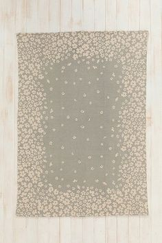 Lovely grey and cream netural rug with floral detailing. 5x7 on sale for $59.99 - $36 after discount. Plum & Bow Serena Rug