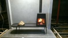 Skantherm Shaker Long Wood stove. - Wendron Stoves.  We love the polished concrete floor.
