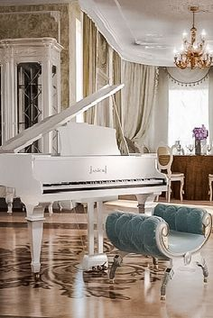 White baby grand piano with turquoise bench