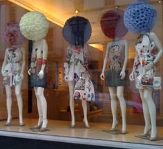 Stella McCartney SS 2011 - mannequin heads with flower from www.silkflowerdecoflora.co.uk