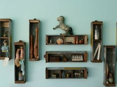 Drawers from old treadle sewing machines would be awesome for this unique shelving idea.
