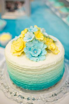 Such a perfect little blue and yellow wedding cake.