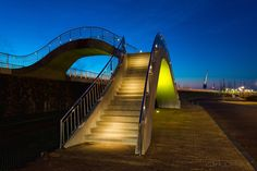 """""""Heavenly Stairs"""", Harlingen, Friesland, The Netherlands - These stairs run along Harlingen's coastal shoreline, providing magical light shots along the rail and roadways"""