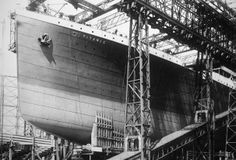 Bow of the Titanic Under Construction: Pictured c. 1910, the Titanic was built at Harland and Wolff shipyard in Belfast, Ireland. At the time of its completion, many claimed that it was indestructible. (Photo Credit: Ralph White/CORBIS)