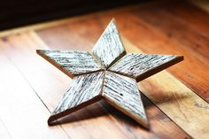 This beautiful wooden star Christmas tree topper is perfect way to top off your beautiful tree! Its made from reclaimed wood and brings country charm to your living room. I hand cut each piece of wood to create these very unique decorations. The back has a leather circle attached in order to place atop your Christmas tree. The leather came from a local Amish leather workers scrap pile. This listing is for a single star tree topper that is approximately 12H x 12W. We also build these as 10…
