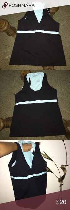 Brazil Workout Top Brazil Workout Top Black & Turquoise Strech. Size Small, High end Top Excellent Condition. Brazil Workout Tops Tank Tops